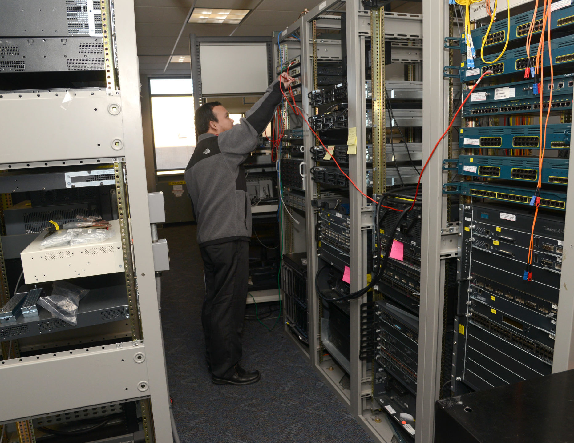 IT Tech working on a server stack