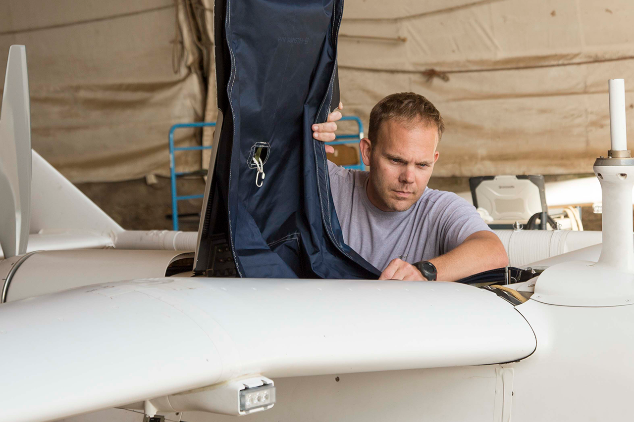 Tim Falco working on a plane