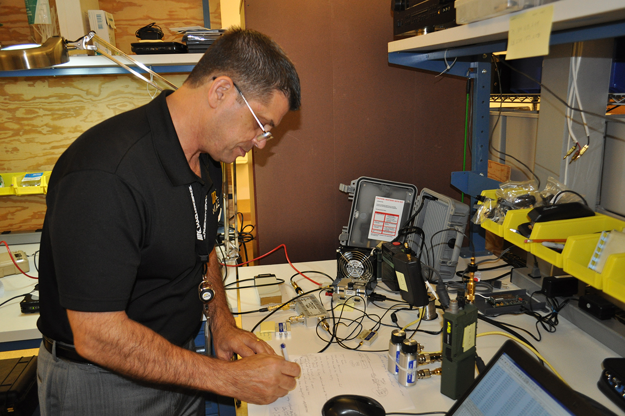 tech in a lab working on electronics