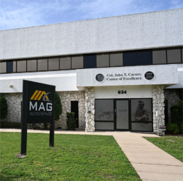 Col. John T. Carney Center of Excellence with Mag Aerospace sign out front
